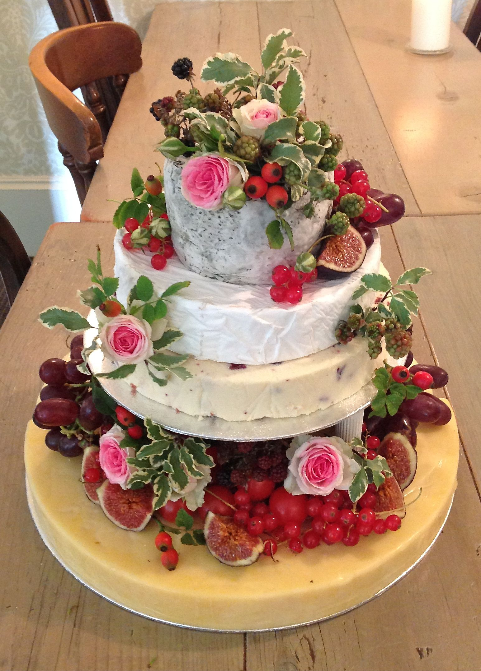 Cheese Wedding Cake Decorated With Fruit And Roses By The Gorgeous