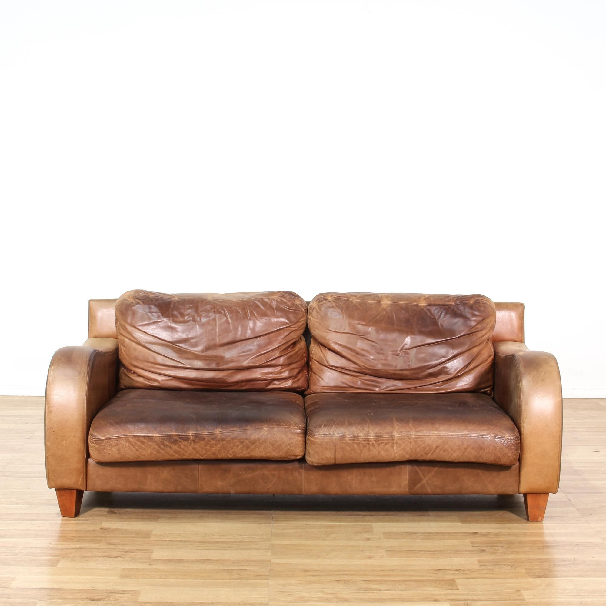 This Sofa Is Upholstered In A Ery Soft Brown Leather Traditional Style Couch Has Curved Arms Plush Cushions And Wooden Feet