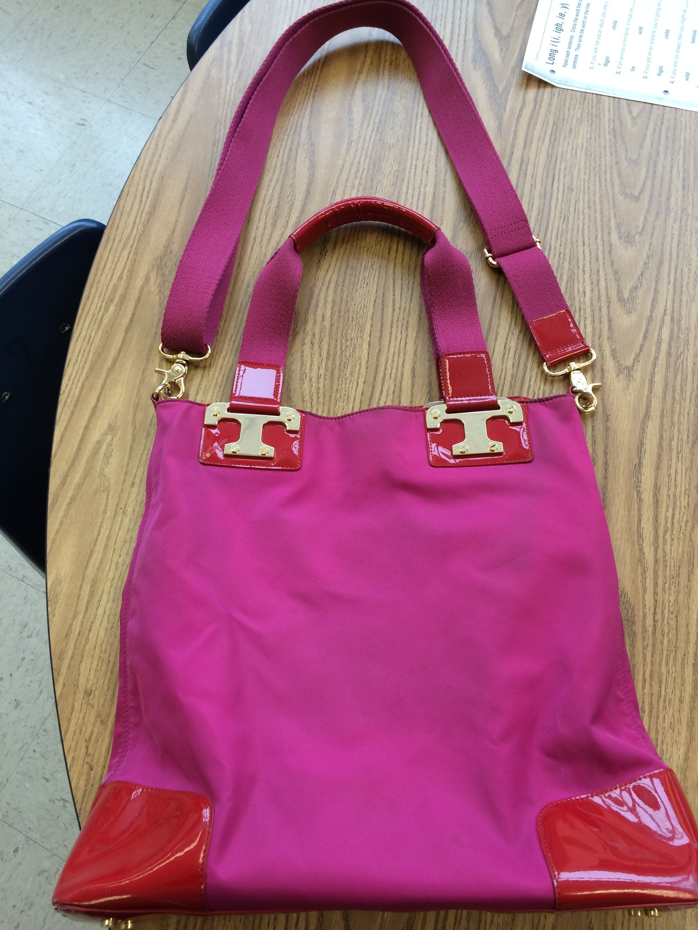 Tory Burch Isla Convertible Crossbody Pink & Red Tote Bag. Get one of the hottest styles of the season! The Tory Burch Isla Convertible Crossbody Pink & Red Tote Bag is a top 10 member favorite on Tradesy. Save on yours before they're sold out!