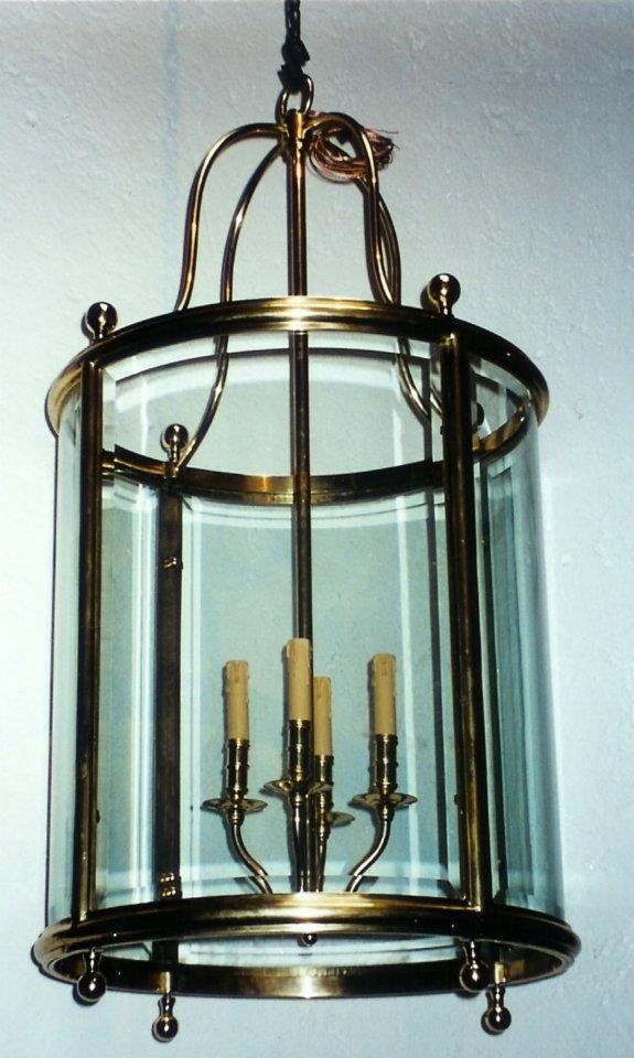 Candil en bronce con apariencia de velas. Cristal
