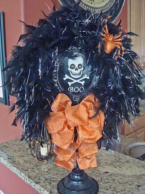 wreath with skull and cross bones