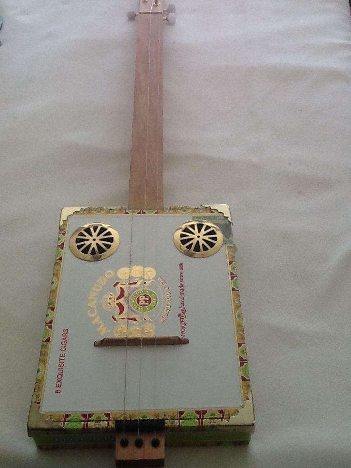Simple acoustic 3 stringer. For sale $75. Visit my shop BlackMountainGuitars on etsy.com