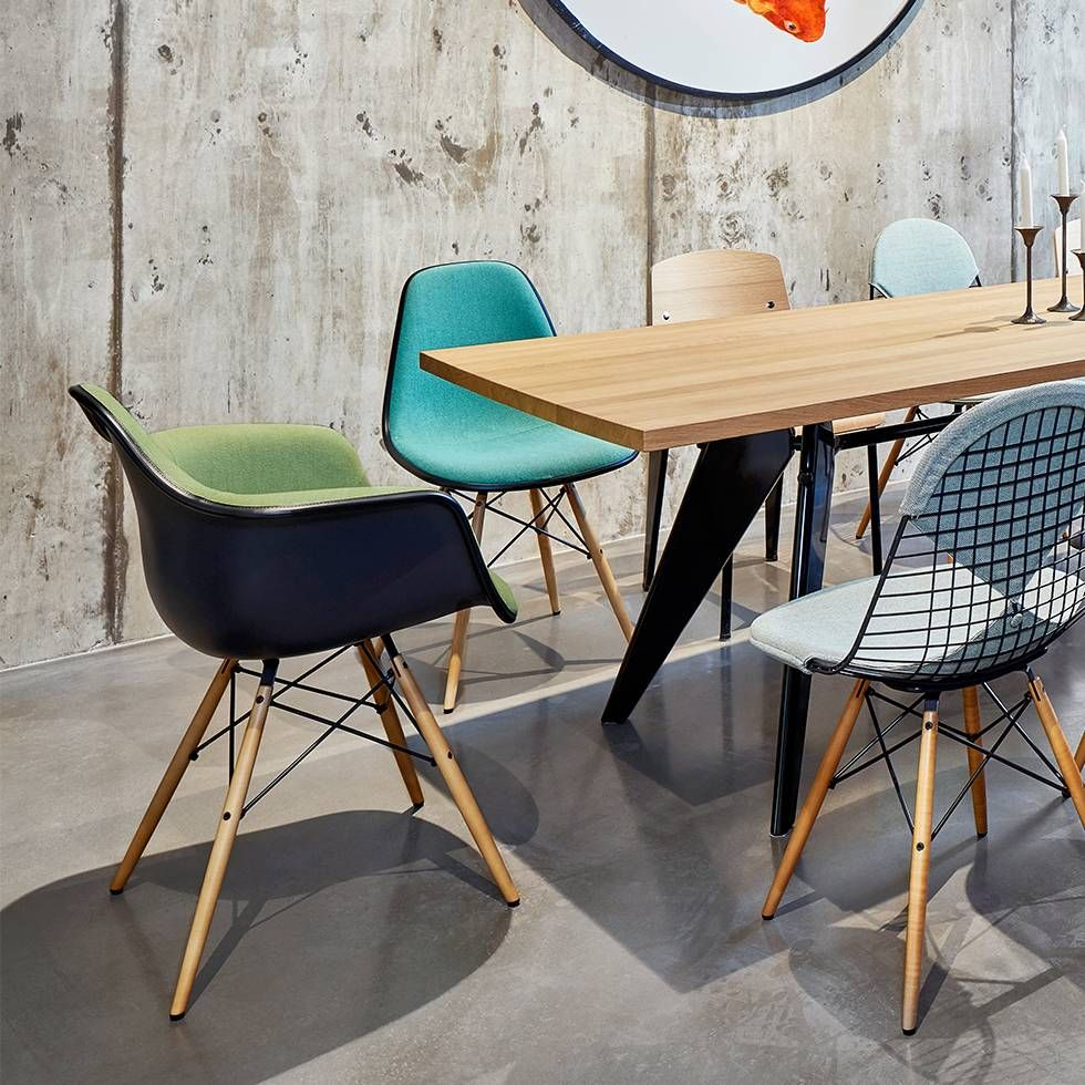 The Vitra Eames Plastic Armchairs DAW, designed by Charles