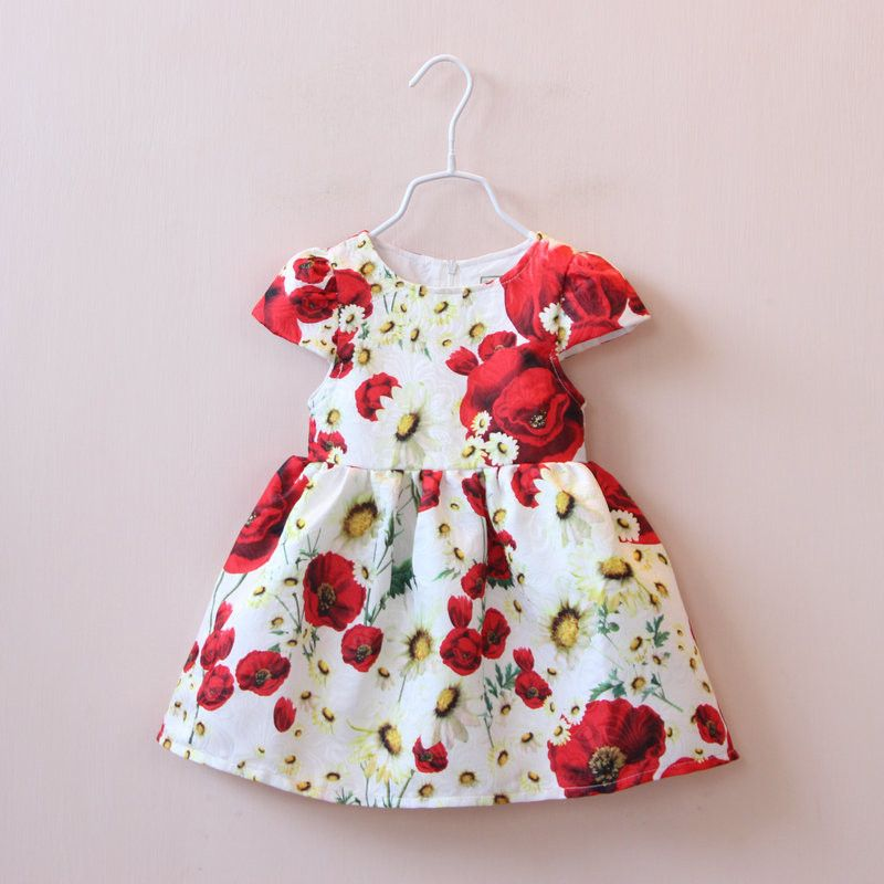 Beautiful and bold poppy and daisy print pattern. Soft cotton lining. Cap sleeves. Back zipper closure.