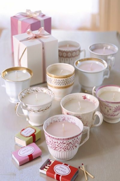 vintage tea cups turned into homemade candles as a wedding favor    http://www.marthastewart.com/273016/teacup-lights