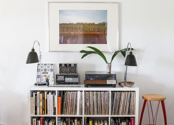 "Homepolish Interior Design | The photo over the record player depicts the Mississippi river and was taken by the Austin-based <a href=""http://www.bspowell.com/"" target=""_blank"">B.S. Powell</a>."
