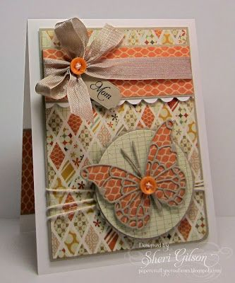 warm neutrals plus a pop of orange for this autumn card...like the use of the diamonds in quilt-like pattern for the background and a print as the solid back behind hte delicately cut butterfly...