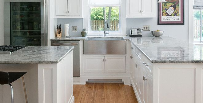 Light Gray Kitchen Walls light pours in from everywhere, suffusing the blue-gray walls and