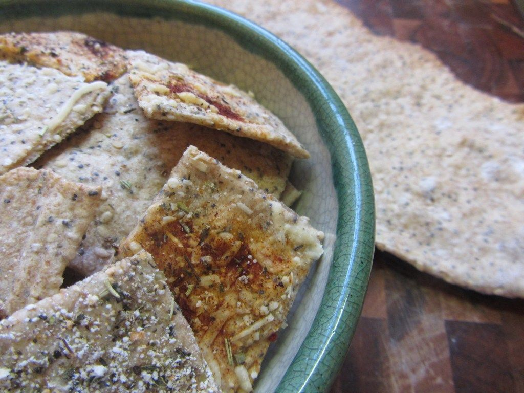Healthy home-made crackers using whole wheat flour, sesame seeds, poppy seeds and other delicious toppings.