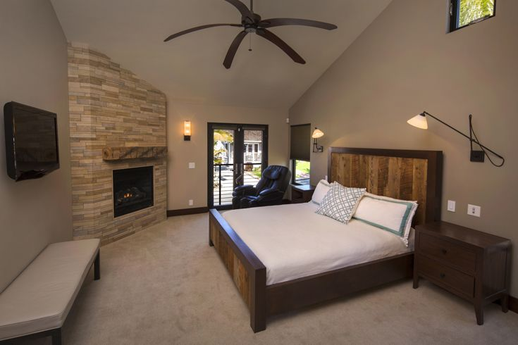 Modern Bedroom: Organic Materials, Natural Materials, modern fireplace, modern stone tile fireplace, modern fan, modern light fixtures, Modern french doors, modern widow, carpet, stain molding, high ceilings,