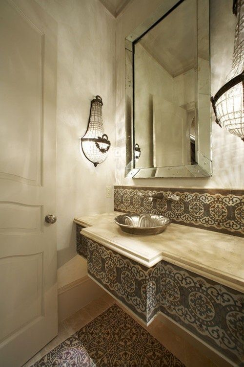 Modern Moroccan bathroom with gorgeous lighting, an embossed sink and some lovely tiling. #Moorish #Bathroom #Moroccan.