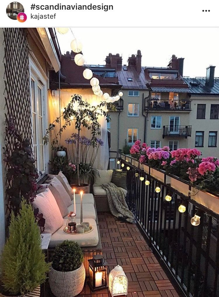 Smart Use Of Long Narrow Space The Flowers And Lights Set This Off Beautifully Small Balcony