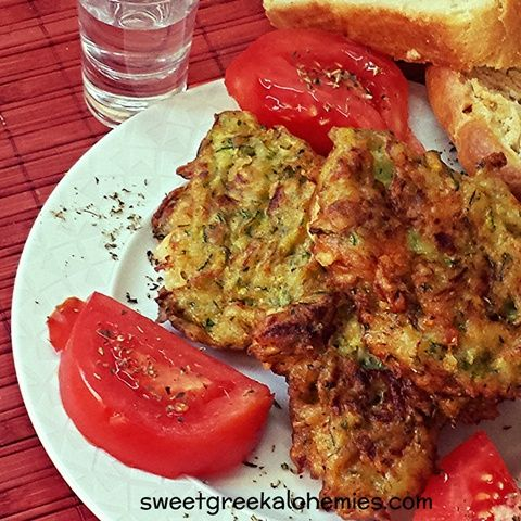 Homemade Zucchini Fritters made with Organic Zucchini and Feta cheese.  See the recipe at sweetgreekalchemies.com