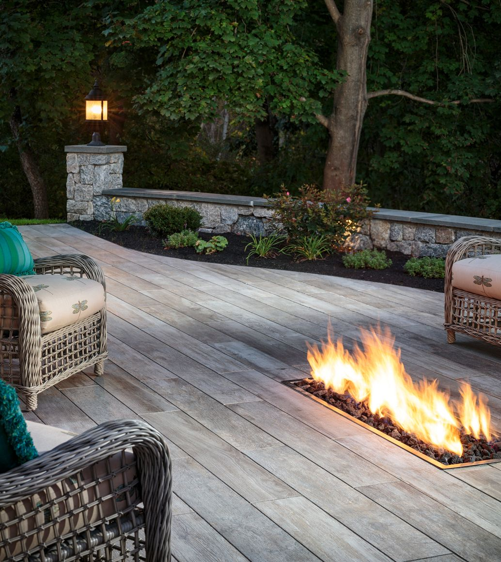 Noon Porcelain Paver Deck Features In-ground Fire