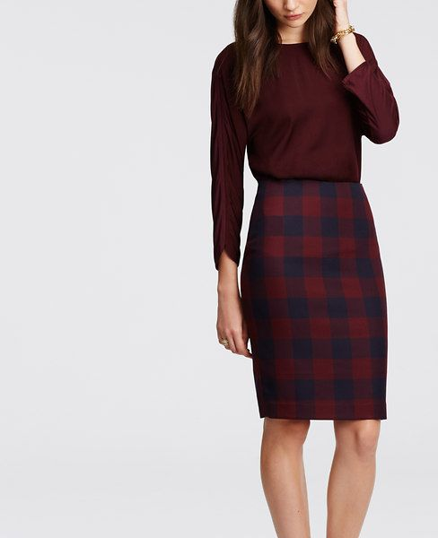 "Slim and sleek in rich seasonal hues, our checkered pencil skirt lands squarely in stylish territory. Our curvy fit, fuller through your hips and thighs. Hidden back zipper with hook-and-eye closure. Back vent. Lined. 23 1/2"" long."