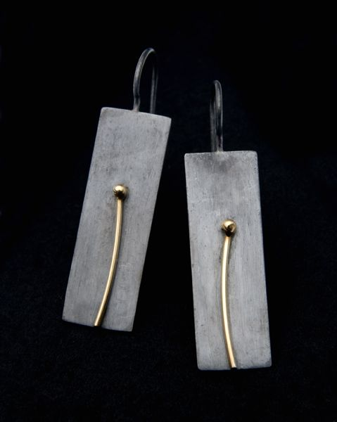 "Kebyar Winter Drops: The Kebyar Winter Drop Earrings are hand fabricated from patinated reclaimed Sterling silver & 18k gold. Kebyar is a Balinese word meaning ""the process of flowering"". These earrings are part of a series reflecting the seasons."