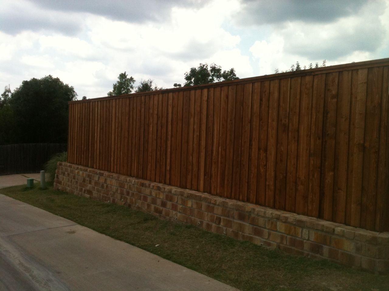 Stone Retaining Wall Backfill And Cedar Fence Board On