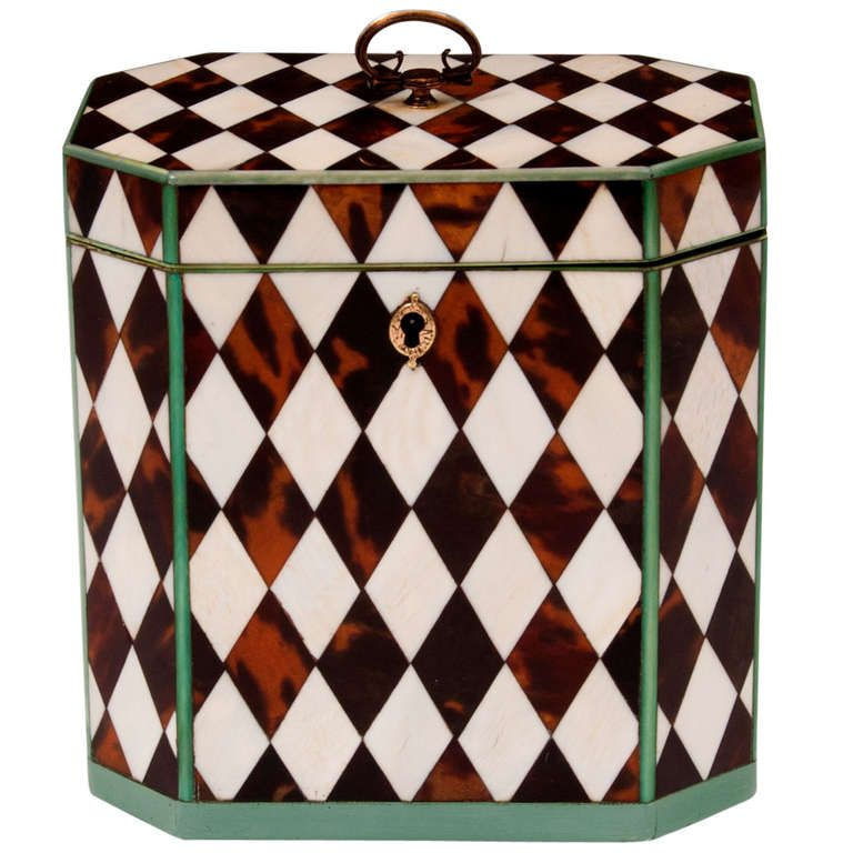 Harlequin Tea Caddy  Tortoiseshell and ivory  HEIGHT:4.5 in. (11 cm) WIDTH:3 in. (8 cm) DEPTH:4.5 in. (11 cm)