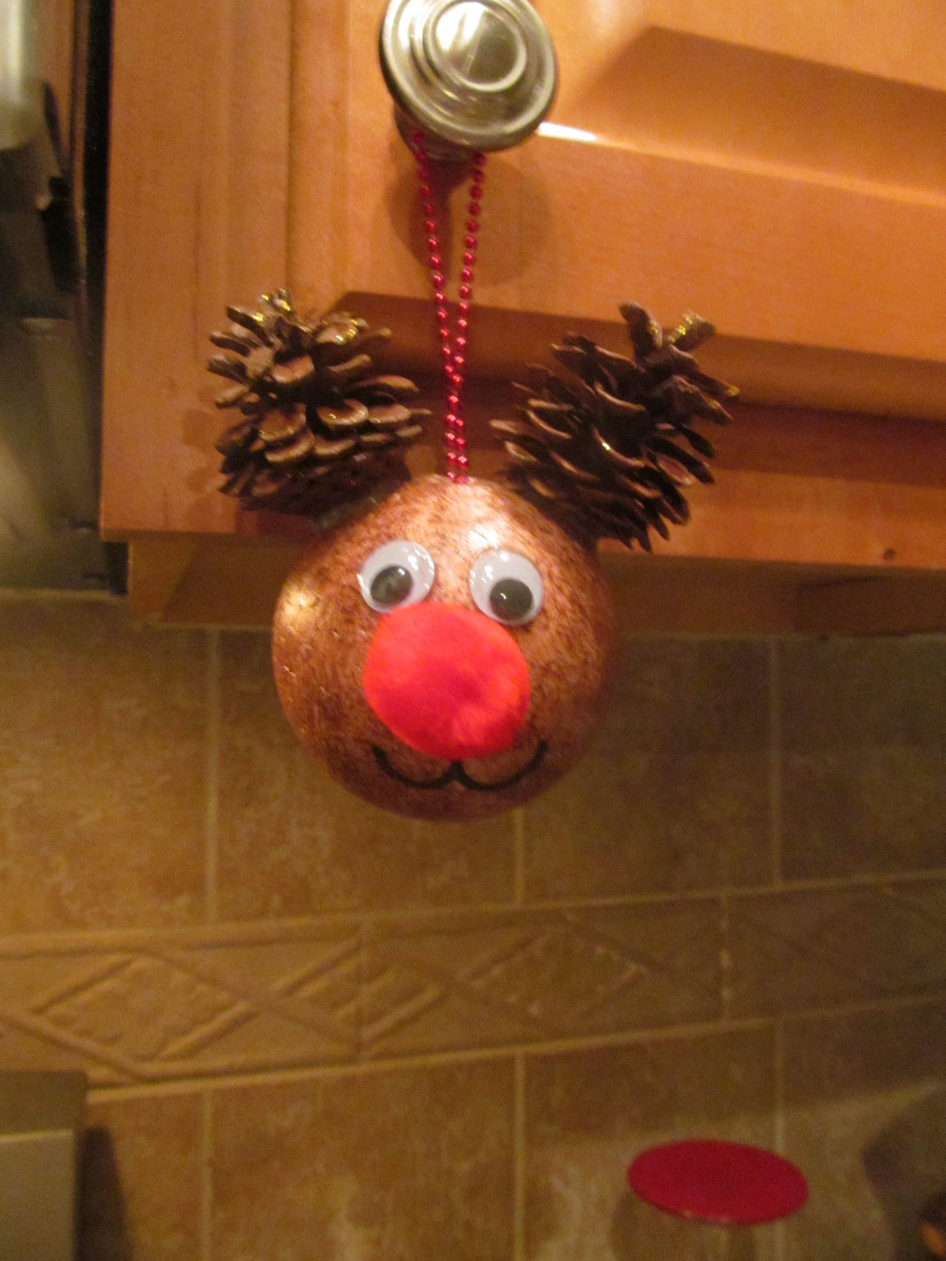 Reindeer ornament made from styrofoam ball painted brown googly
