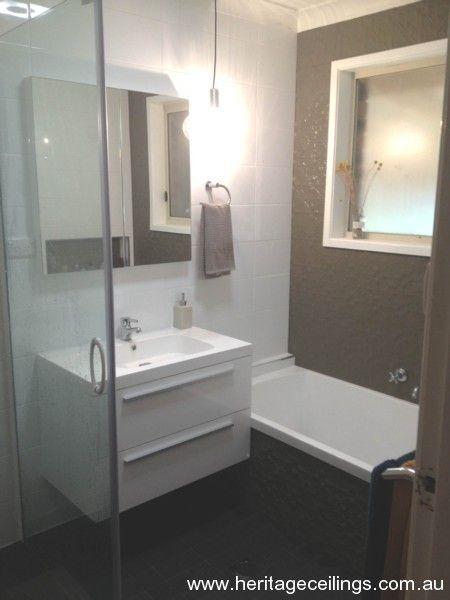 Pressed metal wall in bathroom home bathroom for Feature wall bathroom ideas