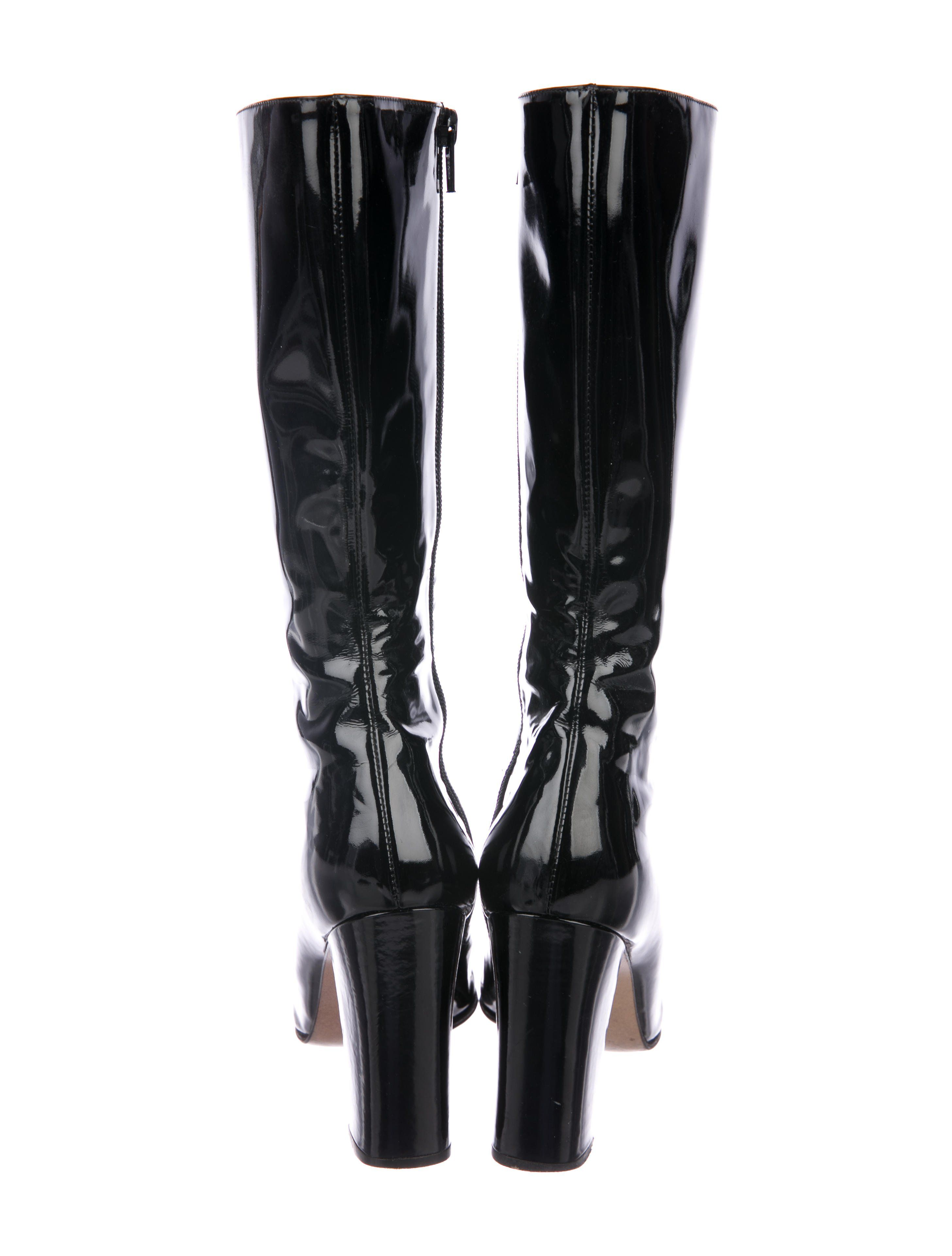 c006c670b Black patent leather Gucci mid-calf boots with silver-tone horsebit  embellishments at vamps, covered heels and zipper closures at insteps.