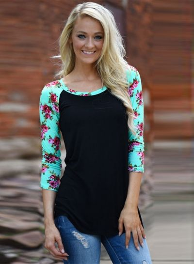 The tee is featuring round neck, pullover style, long sleeve, floral pattern and color block.