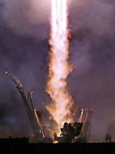 The Soyuz TMA 14 M blasts off from the Baikonur cosmodrome in Kazakhstan carrying Russian cosmonauts Alexander Samokutyaev and Elena Serova and Nasa astronaut Barry Wilmore to the International Space Station.