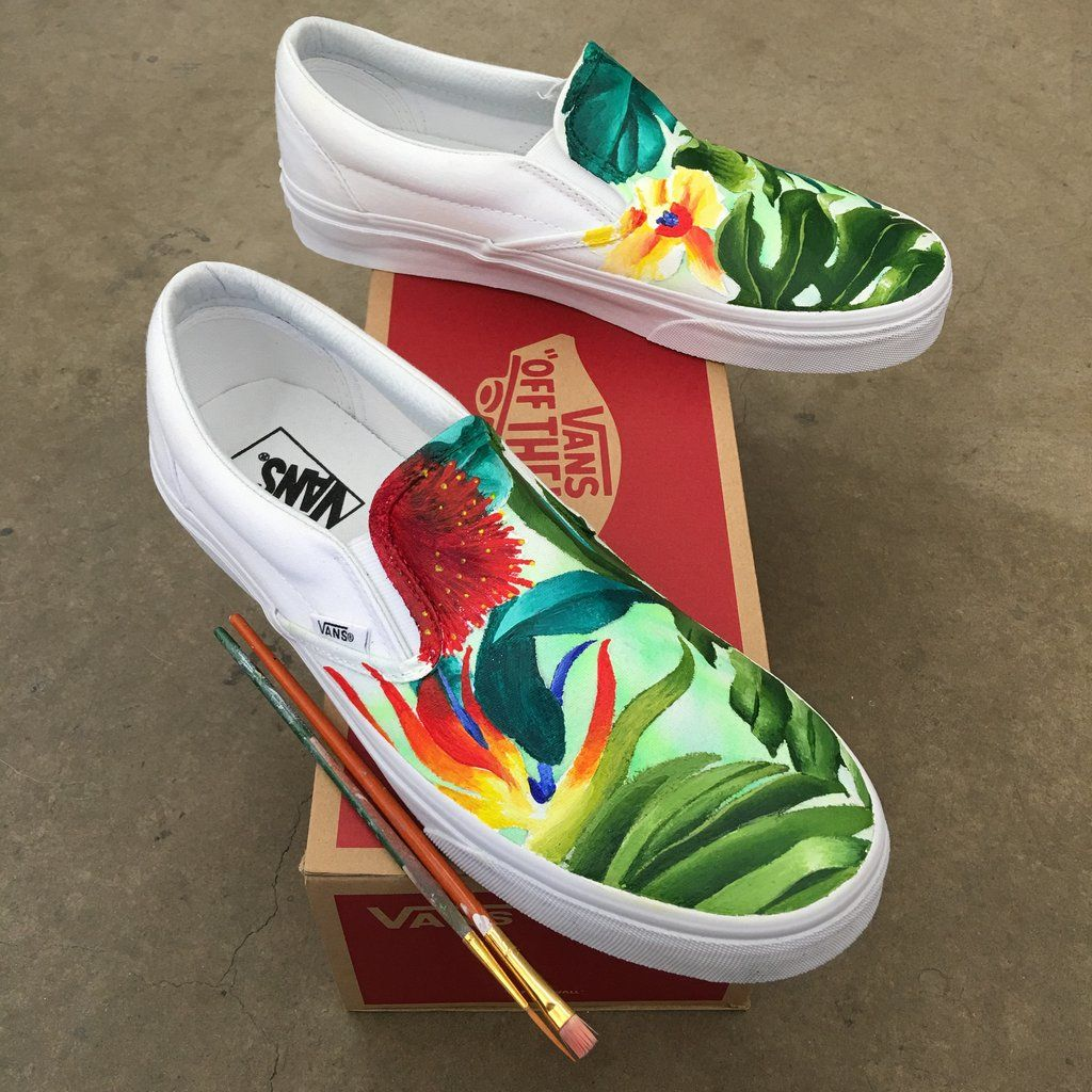 86dfad1ba1 These custom hand painted Vans have been painted with a tropical floral  pattern all over. These custom shoes started out as true white slip on vans.