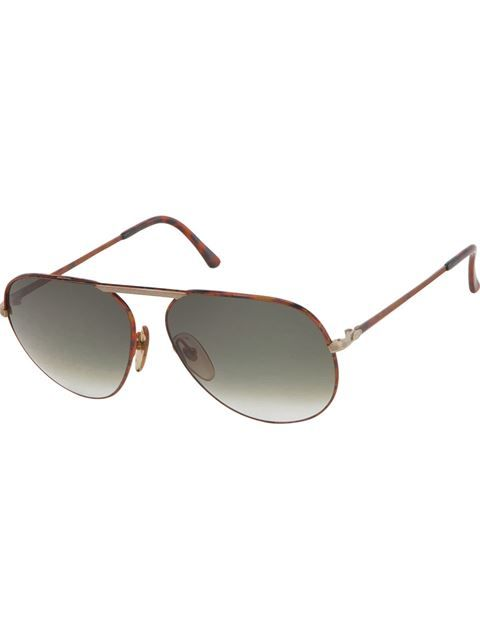 Brown tortoise shell aviator sunglasses from Christian Dior Vintage featuring aviator frames, tinted lenses, thin straight arms and curved temple tips.