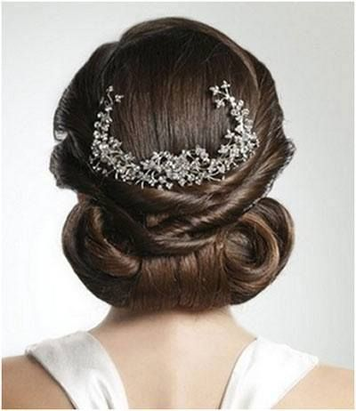 Back crowned party or bridal bun... twirling, twisting, knotting, pinning and spraying.... #bridal #collection