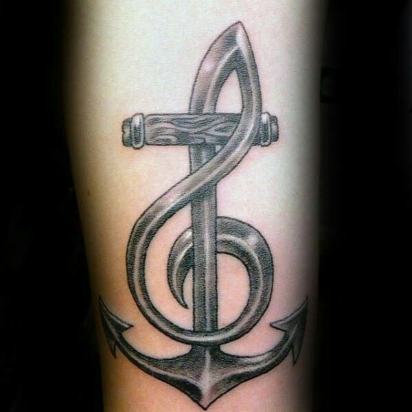 Really cool anchor tattoo with a woven in treble clef. I love how the treble clef looks like metal, just like the bottom of the anchor!