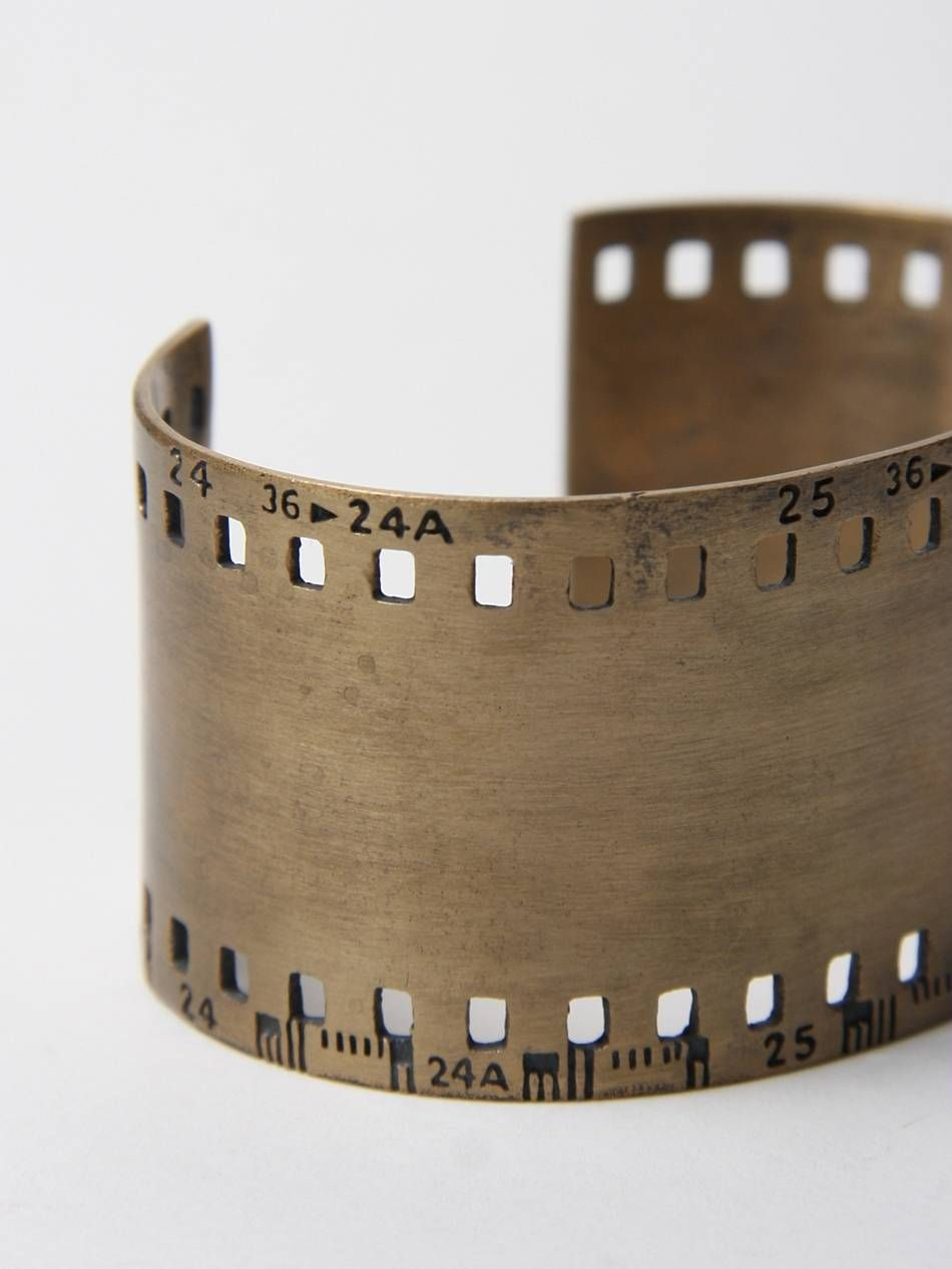 35Mm film strip cuff (used materials - like old film from camera's or films)