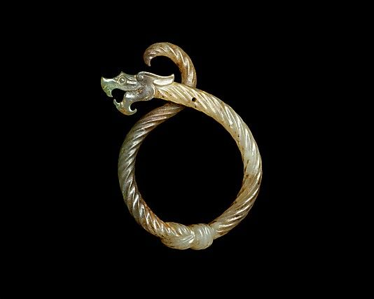 A third-century BC jade pendant in the shape of a knotted dragon. (Metropolitan Museum of Art) - Amazing