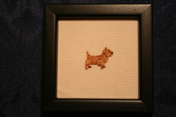 """This is a Cairn Terrier full body print that is hand stitched and hand framed. It is approximately 5"""" x 5"""". I can personalize this print by"""