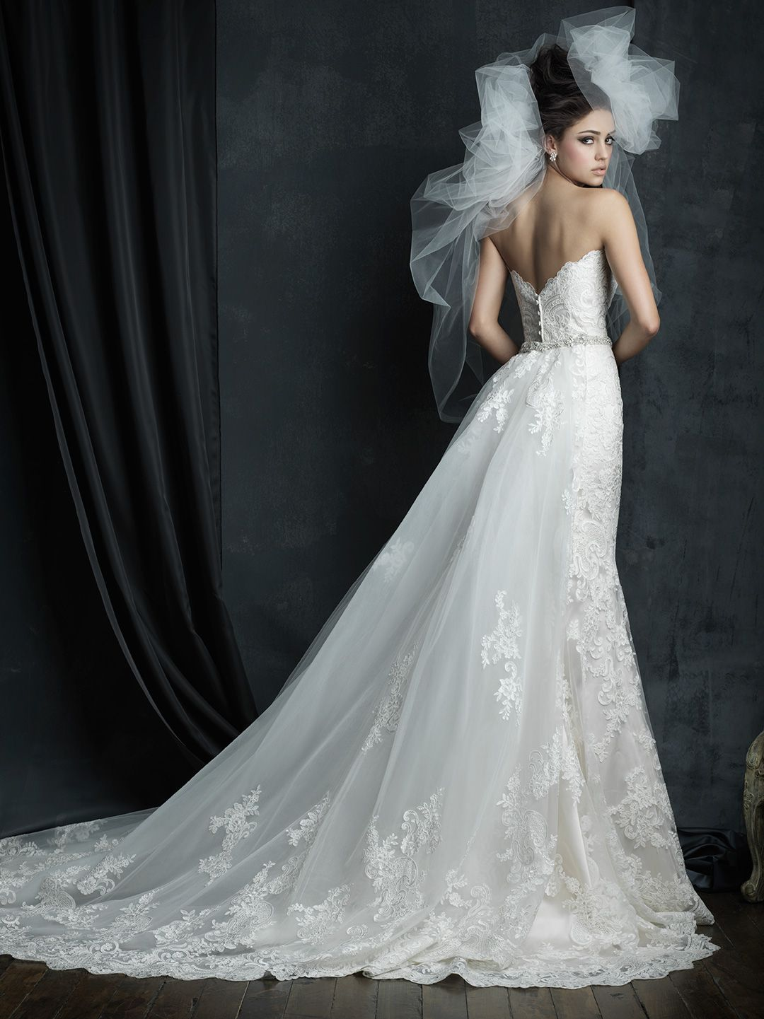 This strapless lace gown features a gorgeous detachable train ...