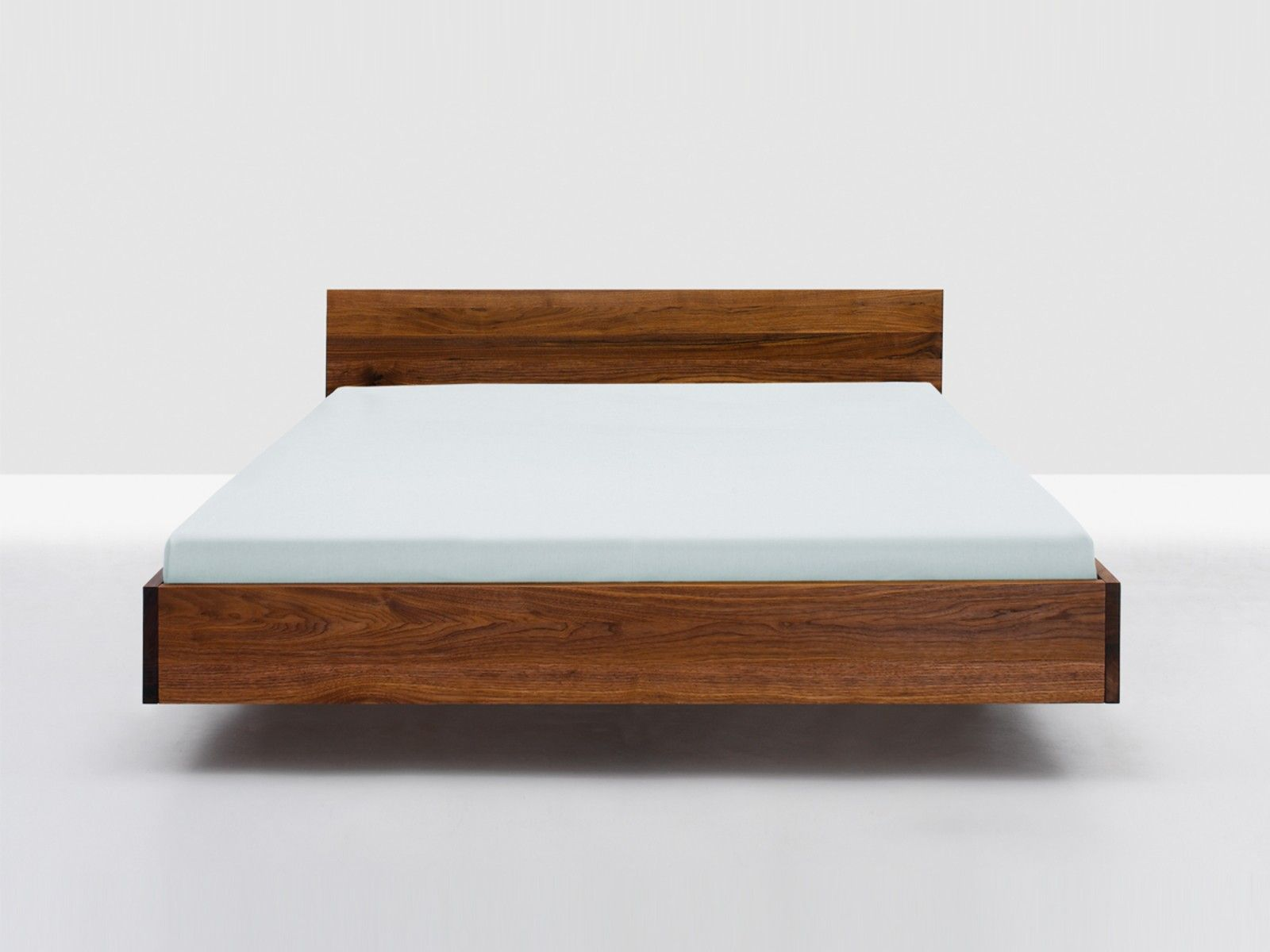 Magnificent Floating Low Twin Bed Frame With Brown Mahogany Materials As Well As White Covered Bed Set In Simple Guys Bedroom Decors