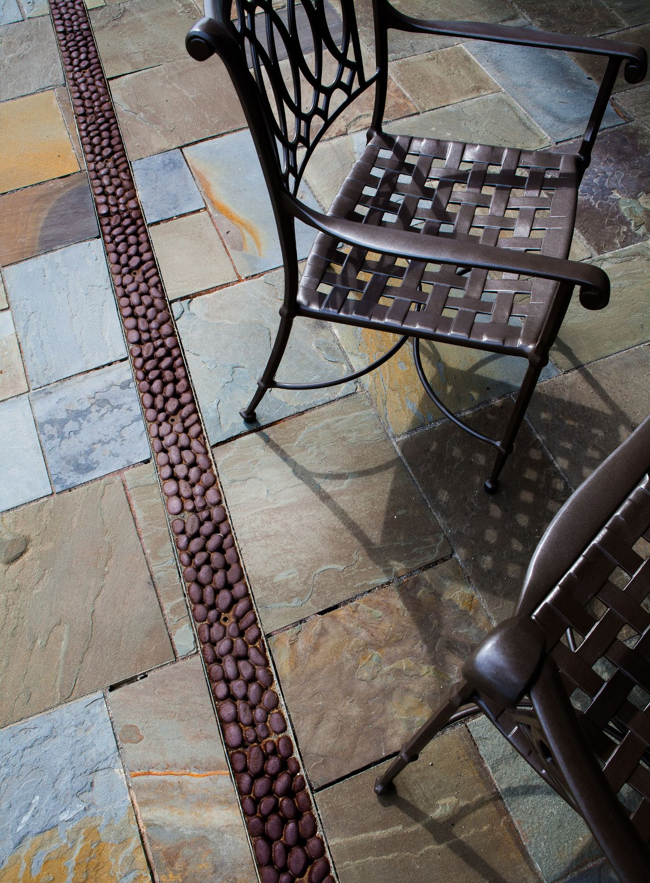 River rock trench drain iron age grates garden elements and made in the usa iron age designs drain cover dailygadgetfo Image collections