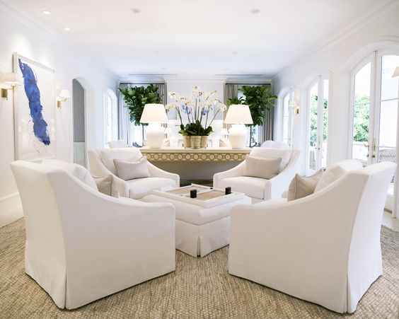 Living Room Conversation Area With Four Chairs And Ottoman