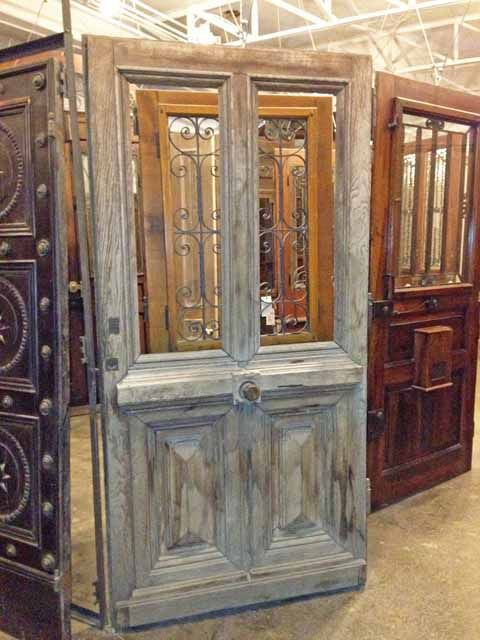 make into a dutch door -- handle on the side (not in middle).  Love the detail of the raised panels on the bottom.