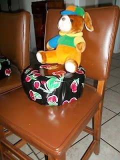 Cookie can   oilcloth = booster chair for a big toddler  DIY toddler seat