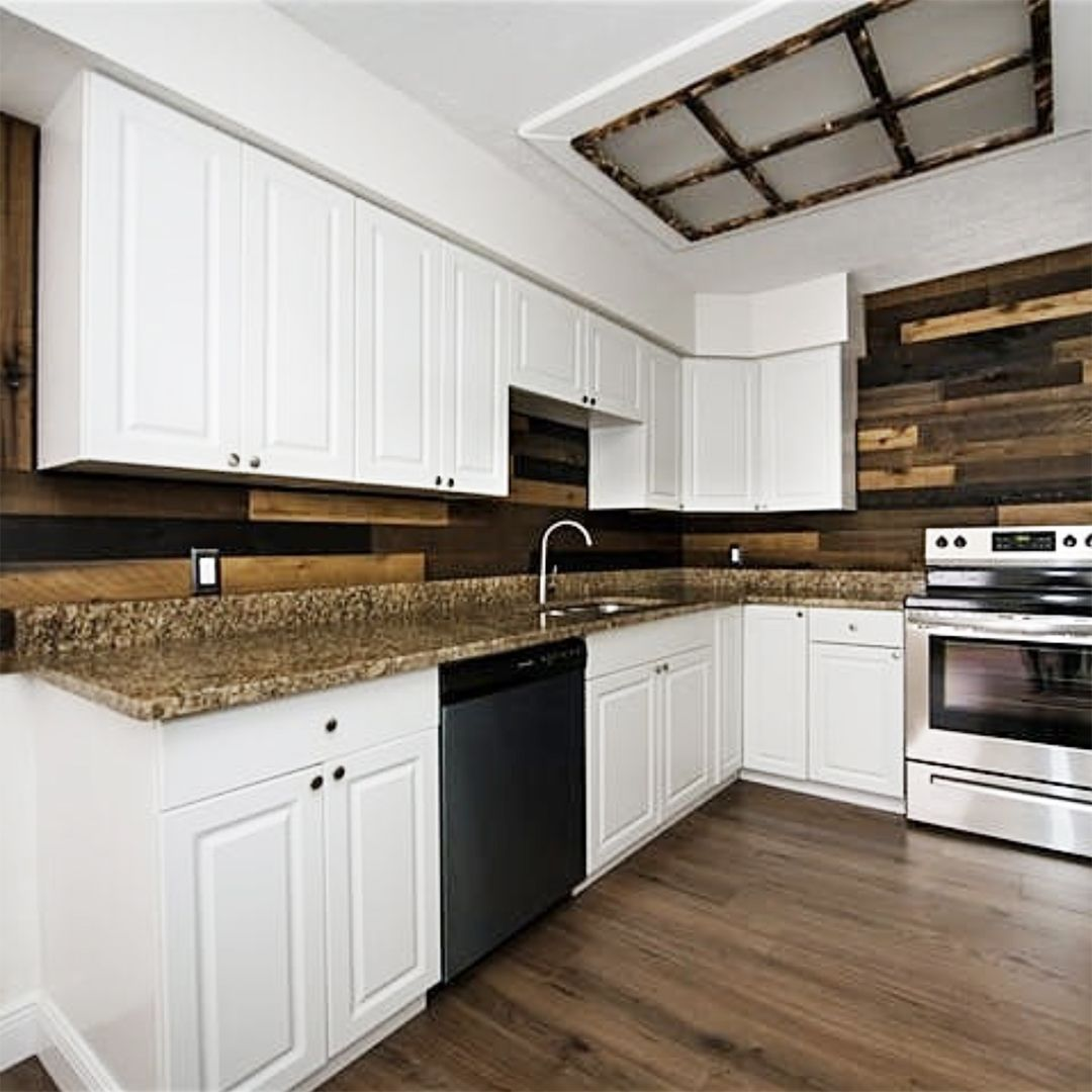 Weathered Wood Warms Up And Unifies This White Farmhouse Style Kitchen Get This Look With Our Weathered Wal In 2020 Farmhouse Style Kitchen Wall Board Diy Home Decor