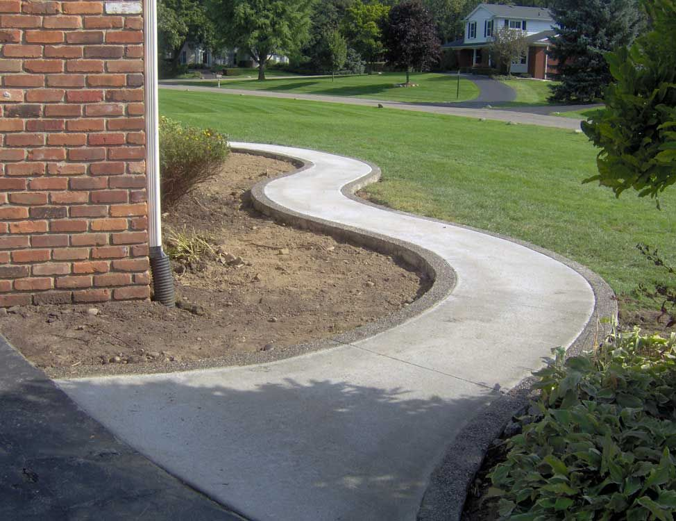 Concrete Front Walk : Winding broom finish standard concrete walkway with