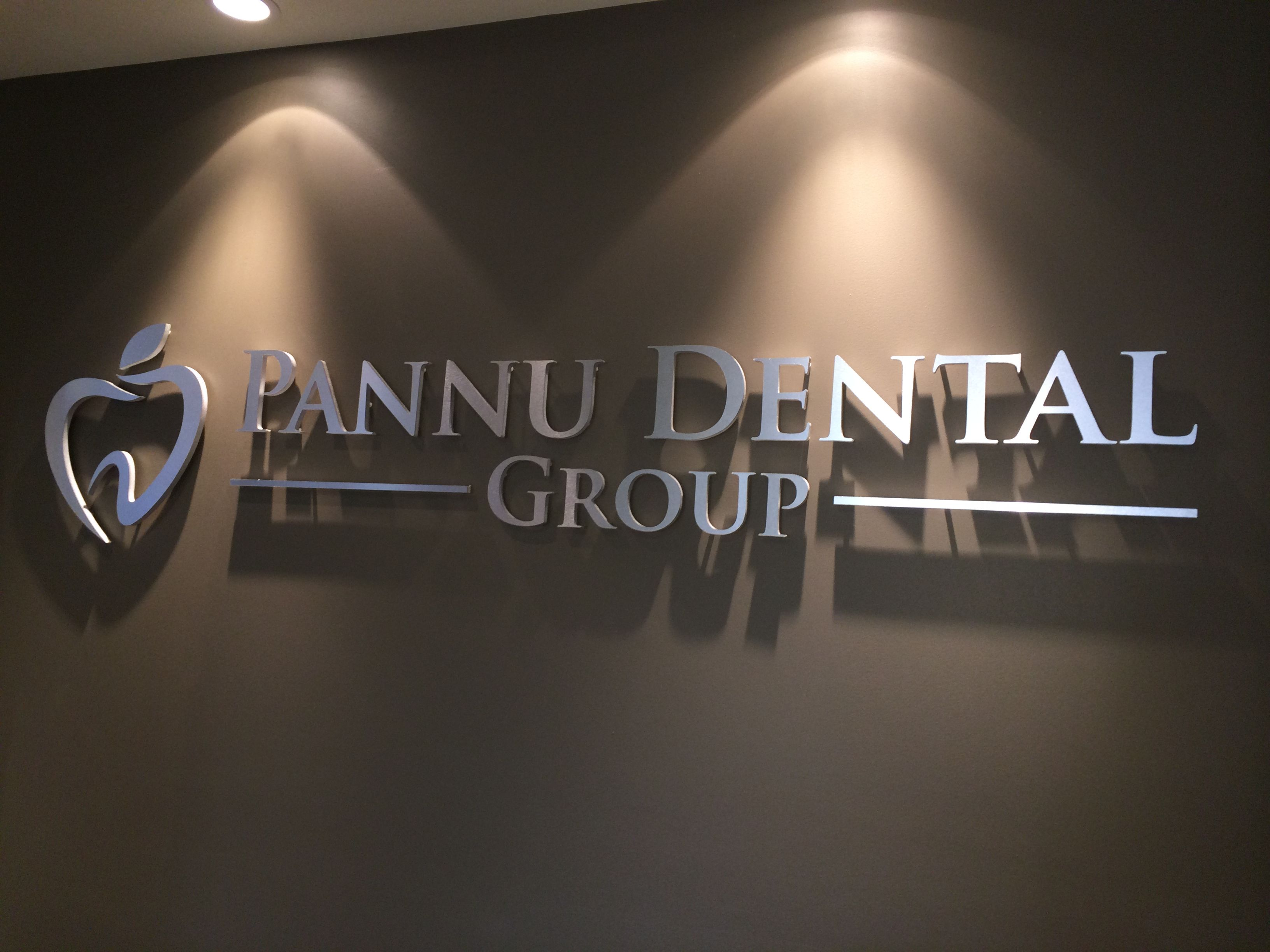 Brushed metal finish dentist office wall sign mounted with studs ...