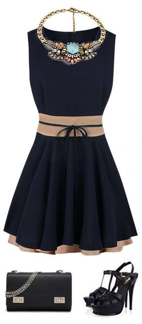 0d73b3b71d9 I really like the look and navy color of this dress. Very classic. I like  the touches of nude on the belt line and bottom. Very pretty.