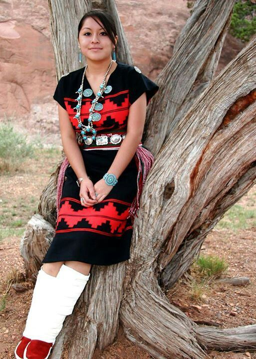Young Navajo Woman In Traditional Rug Dress Moccasin Wraps And Turquoise Jewelry