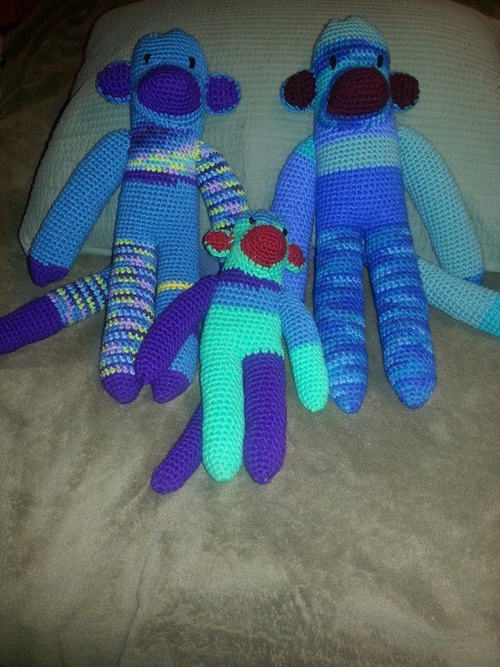 "Made these three sock monkeys for my three grandsons.  I used a patten from ""coats and Clark"" for the big monkeys .  The small one I made on my own by alternating the pattern."
