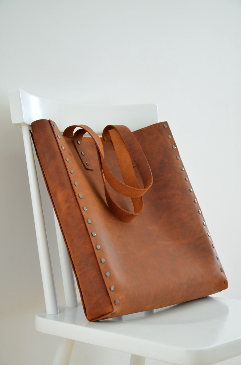 The Squareforma Tote in Brown Minimalist and simple capacious and elegant handmade leather bag will fit everything you need It is perfect for work or for the lazy afterno...