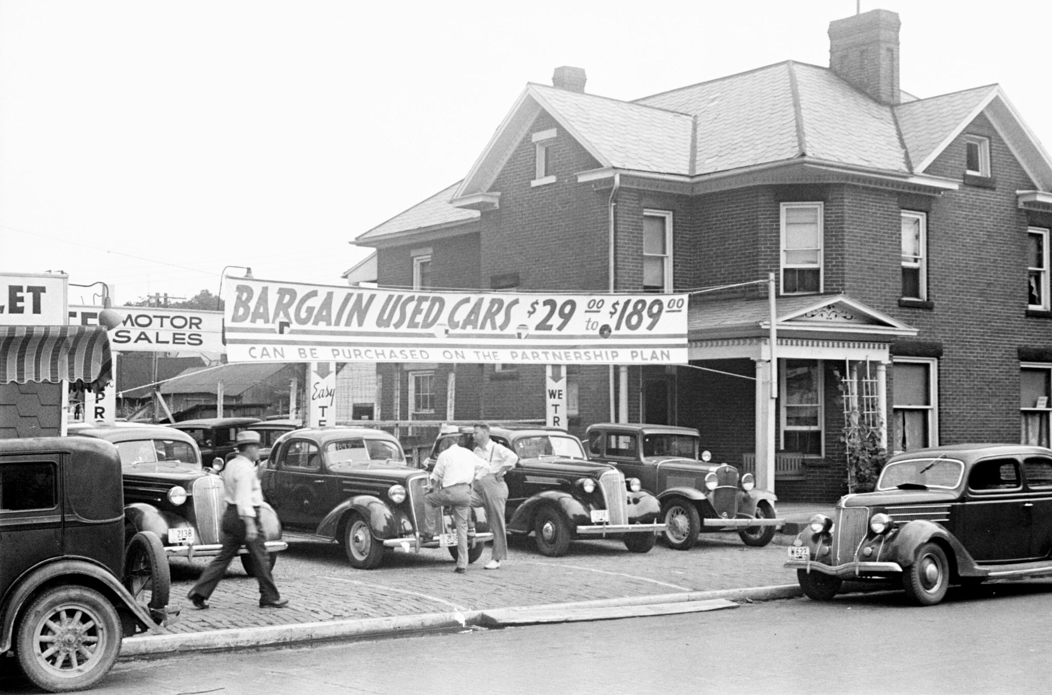 1938 used car lot in lancaster ohio note the signage