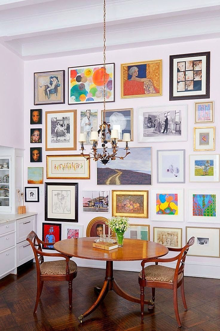 A large gallery wall fills the room with color motion and beautiful