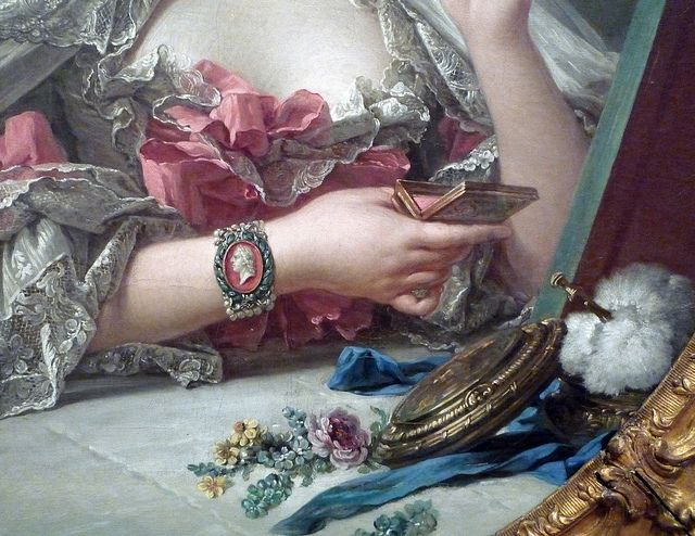François Boucher, Madame de Pompadour (detail of still life), oil on canvas, 1750.  Clothing designers did not exist at the time.  Merchants came calling with fabrics and millinery and then one had one's clothes made to mesure.  Madame de Pompadour created all her own clothes and was known to be the trend setter at court.